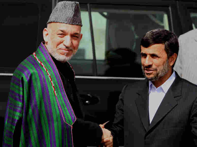 Afghan President Hamid Karzai greets visiting Iranian President Mahmoud Ahmadinejad on March 10.