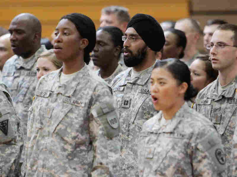 U.S. Army Capt. Tejdeep Singh Rattan, center wearing turban, stands with other graduates.