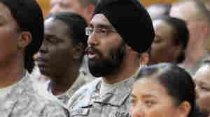 U.S. Army Capt. Tejdeep Singh Rattan, wearing turban, stands with other graduates.