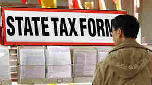 Qiao Ming picks out state tax forms in 2008.
