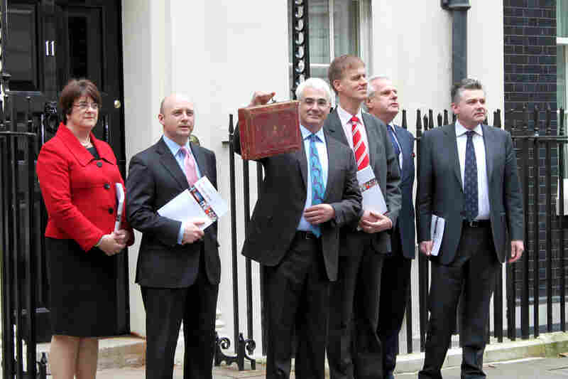 Chancellor Alistair Darling holds his red dispatch box as he stands  at No.11 Downing St.