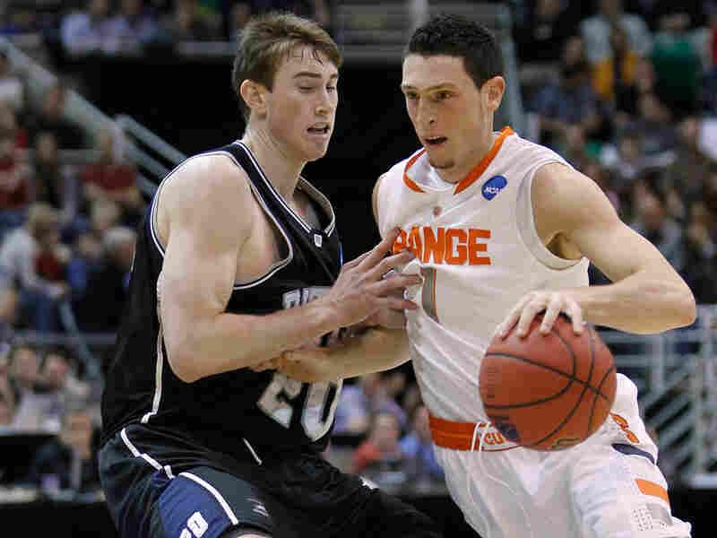 Syracuse's Andy Rautins, right, drives against Butler's Gordon Hayward.