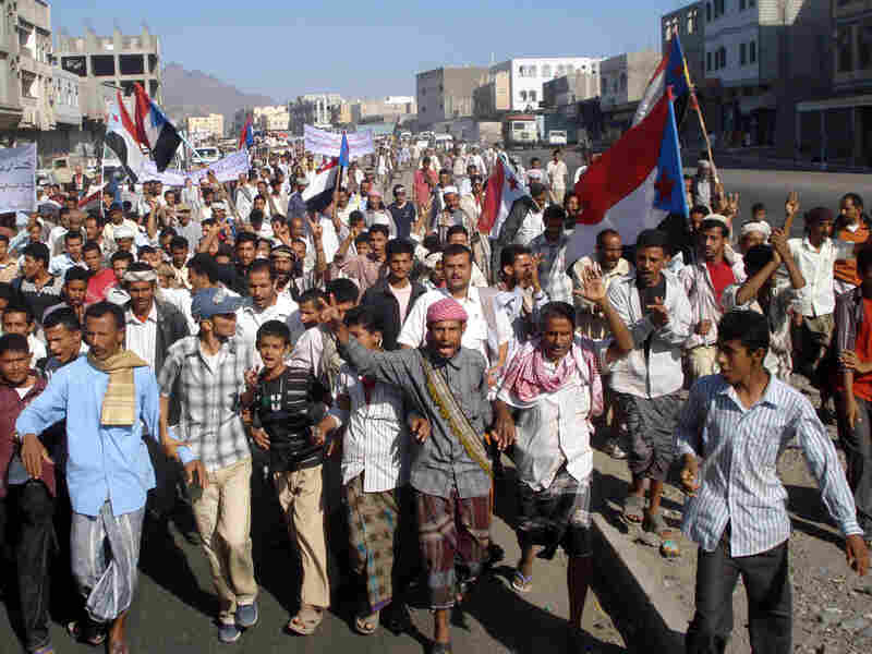 Yemeni protesters shout slogans during a demonstration against a government raid on al-Qaida targets