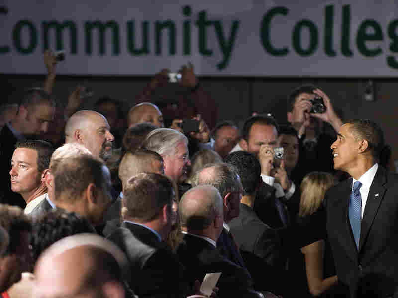 President Obama shakes hands at an event at Hudson Valley Community College