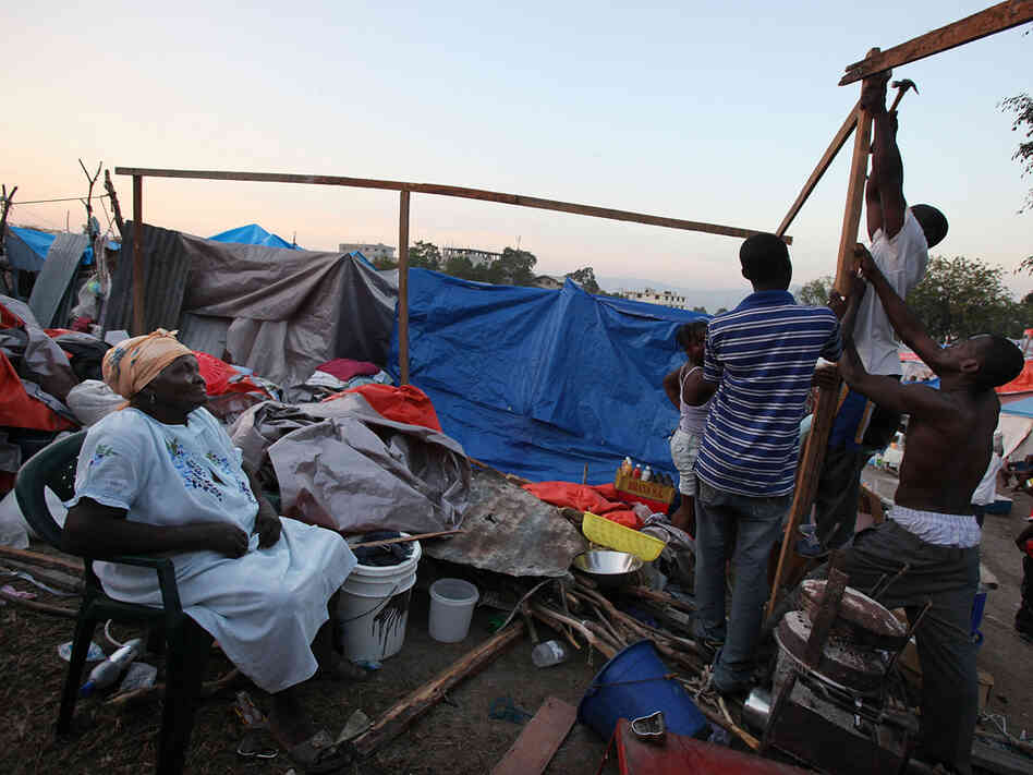 Earthquake survivors construct a makeshift encampment on a golf course in Port-au-Prince.