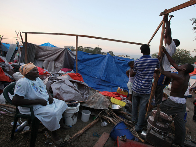 Earthquake survivors construct a makeshift encampment on a golf course in Port-au-Prince on Feb. 13.