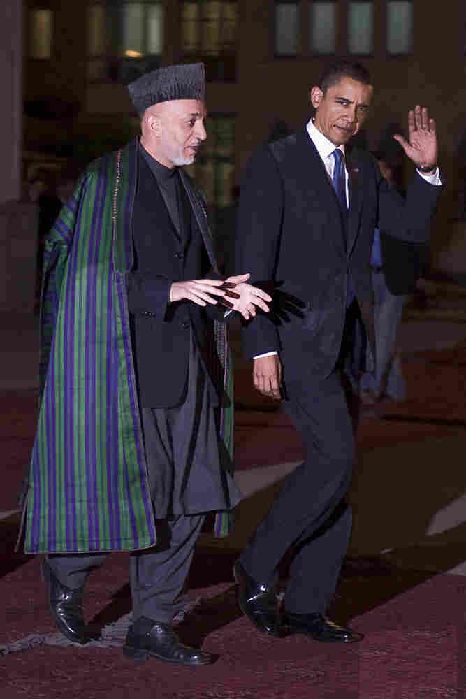 President Barack Obama walks with Afghan President Hamid Karzai