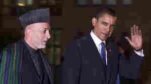 President Barack Obama walks with Afghan President Hamid Karzai