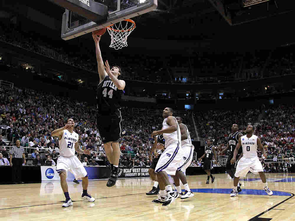 Butler's Andrew Smith rises above several players to lay in a basket.