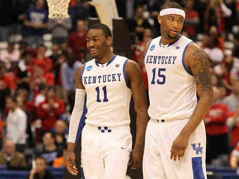 Kentucky's John Wall and DeMarcus Cousins celebrate win over Cornell.
