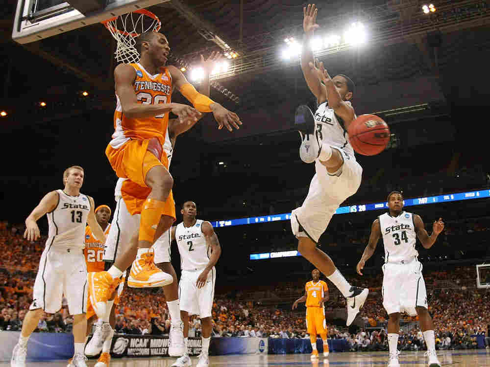 J.P. Prince of Tennessee passes the ball as Chris Allen of Michigan State defends.