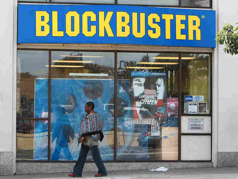 A pedestrian walks by a Blockbuster store in San Francisco last week.