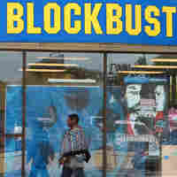 A pedestrian walks by a Blockbuster store in San Francisco last week.
