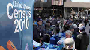 Census workers inform Brooklyn, N.Y., residents of the census count in March 2010.