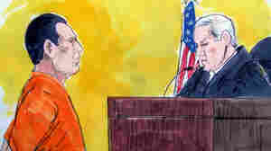In this courtroom drawing, David Coleman Headley faces a federal judge