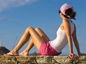 Woman sitting in the sun.