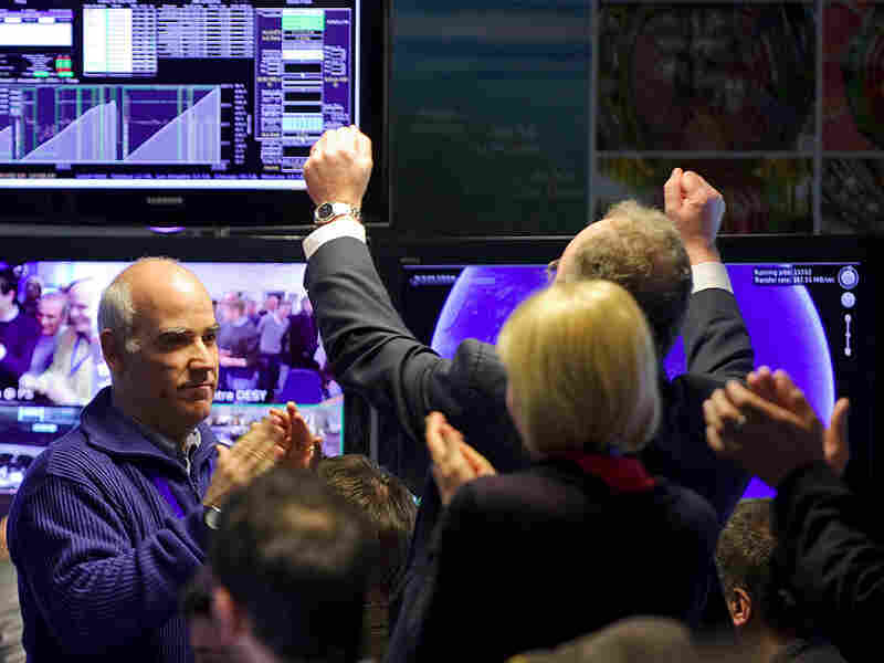 Scientists celebrate after the Large Hadron Collider started smashing protons at record power.