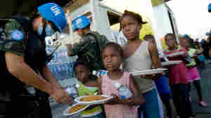 United Nations troops from Bolivia distribute water and meals