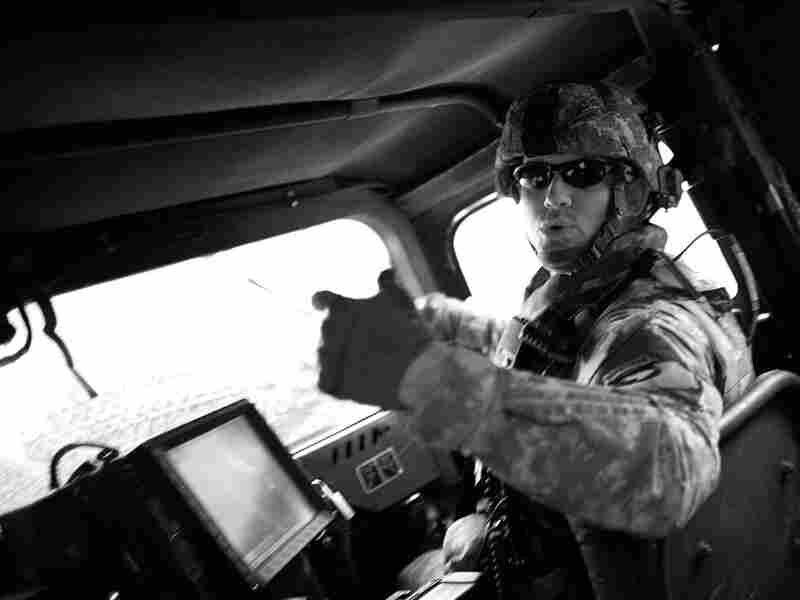 Captain Mike Miller rides in his Humvee during a training mission at Fort Polk, La.