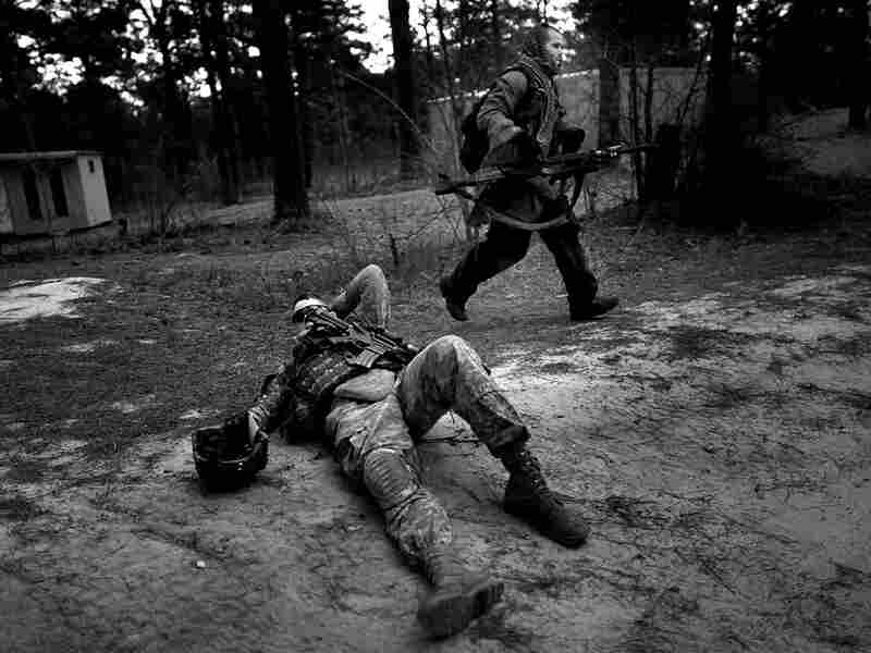 A soldier plays an insurgent fighter in a training mission.