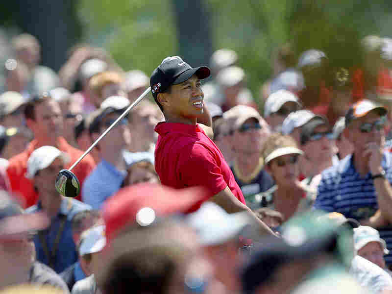 Tiger Woods watches his tee shot on the first hole during the final round of the 2009 Masters.