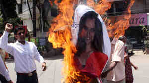 Indian right-wing nationalist protesters burn an effigy of tennis player Sania Mirza