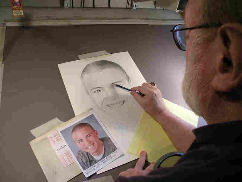 Michael Reagan at his drawing table.