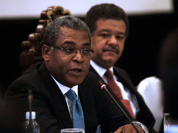 Haitian Prime Minister Jean-Max Bellerive addresses an audience during a meeting on March 17 in Santo Domingo.