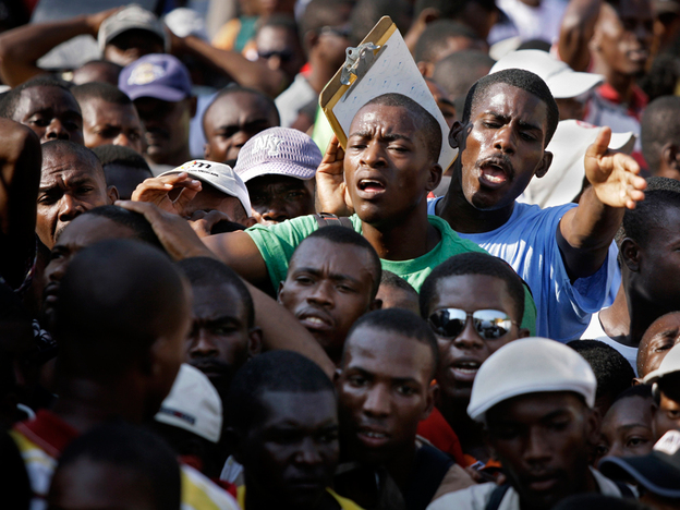 Unemployed Haitians, survivors of the Jan. 12 earthquake, gather outside a job agency last week while inquiring about possible positions at a local hospital in Port-au-Prince.