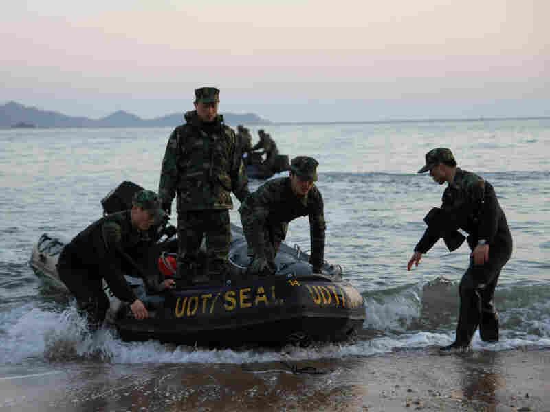 South Korean marines return to a beach on Baengnyeong Island