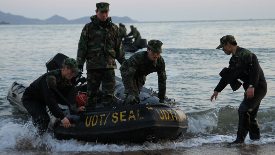 South Korean marines return to a beach on Baengnyeong Island following a search operation to find 46 missing sailors after a mysterious explosion ripped the sailors' ship in half March 26.