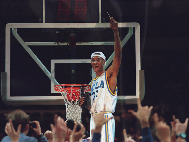 Forward Ed O'Bannon cuts down the nets after UCLA's 1995 win in the NCAA West Region final. UCLA went on to win the national title that year, and O'Bannon was voted the Final Four's Most Outstanding Player. Now, he's headlining a class-action lawsuit against video-game maker Electronic Arts and the NCAA to get compensation for the use of players' likenesses.