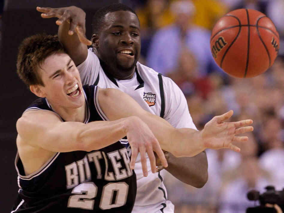 Butler's Gordon Hayward, left, battled all night with Michigan State's Draymond Green
