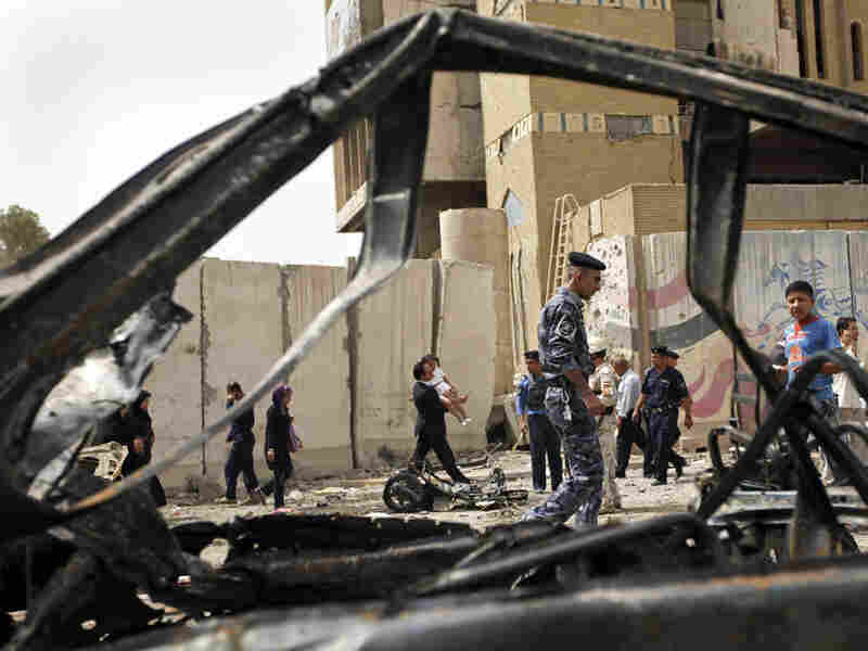 Iraqis inspect site of car bomb near Iranian Embassy in Baghdad