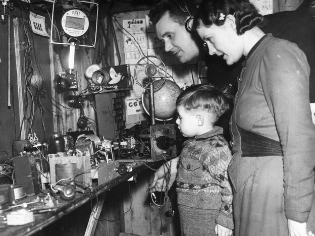 Stanley Hardman, an amateur radio operator, and his family look at transmitting equipment in 1939.