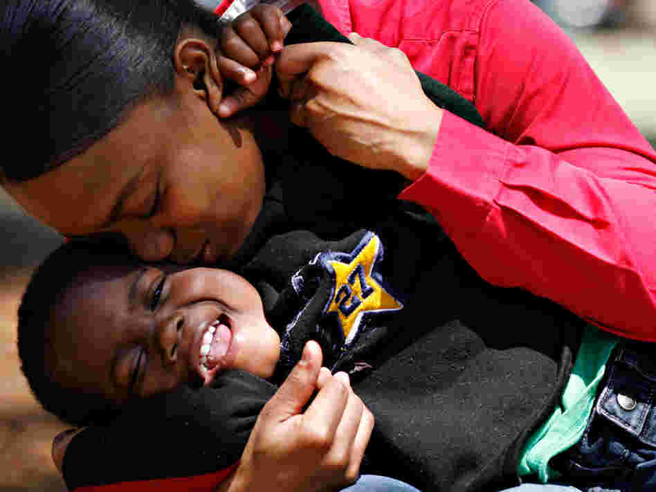 Katrena Wingo, who spent most of her life in foster care, kisses her son.