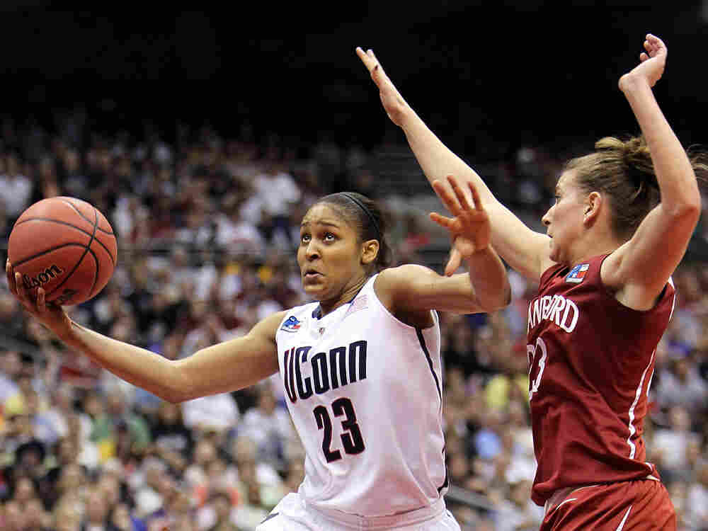 Connecticut star Maya Moore drives past Stanford's Jeanette Pohlen