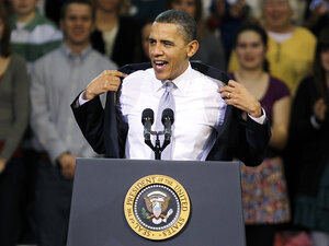 President Obama removes his coat before his speech on health insurance reform in Iowa in late March.