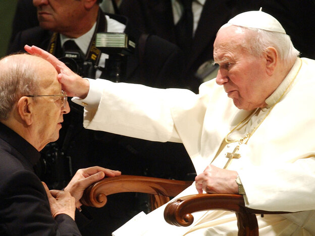 In this Nov. 30, 2004, file photo, Pope John Paul II gives his blessing to Marcial Maciel Degollado of Mexico, founder of the Legion of Christ. Allegations have surfaced that the late pope — or at least members of his inner circle — obstructed an investigation into allegations of sexual misconduct against Maciel.
