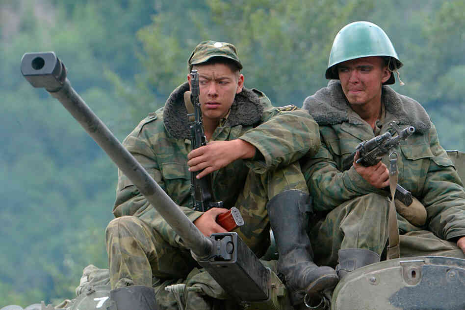 Russian soldiers seen atop a military vehicle in the disputed South Ossetia region in August 2008.