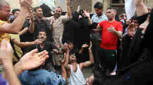 Family members mourn at the funeral of a victim of the April 7 bombings in Baghdad