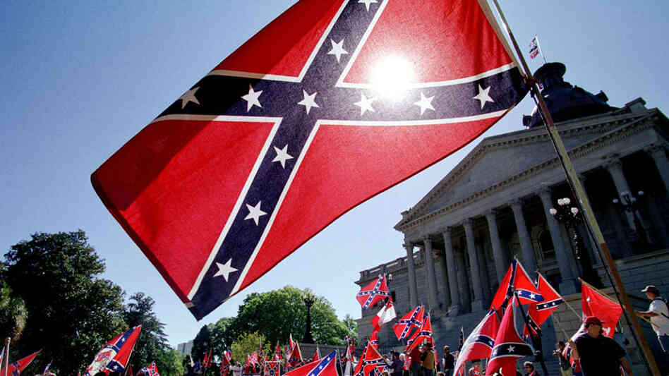 Confederate flag supporters demonstrate on the north steps of the capitol building 06 April, 2000 in