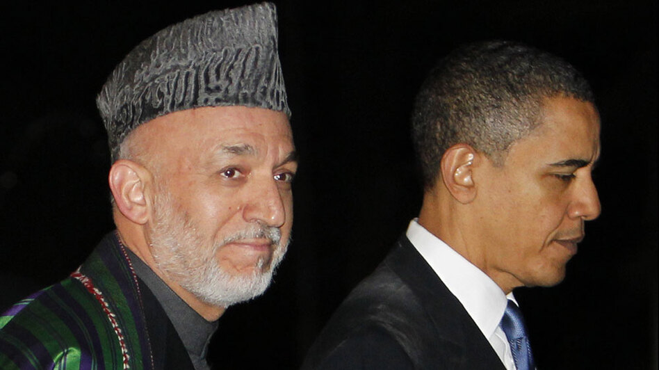 President Obama walks with Afghan President Hamid Karzai at the presidential palace in Kabul on March 28. In recent comments, Karzai has blamed the West for many of his troubles, causing concern in Washington.