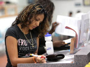 Janessa Rivera fills out a form for unemployment benefits