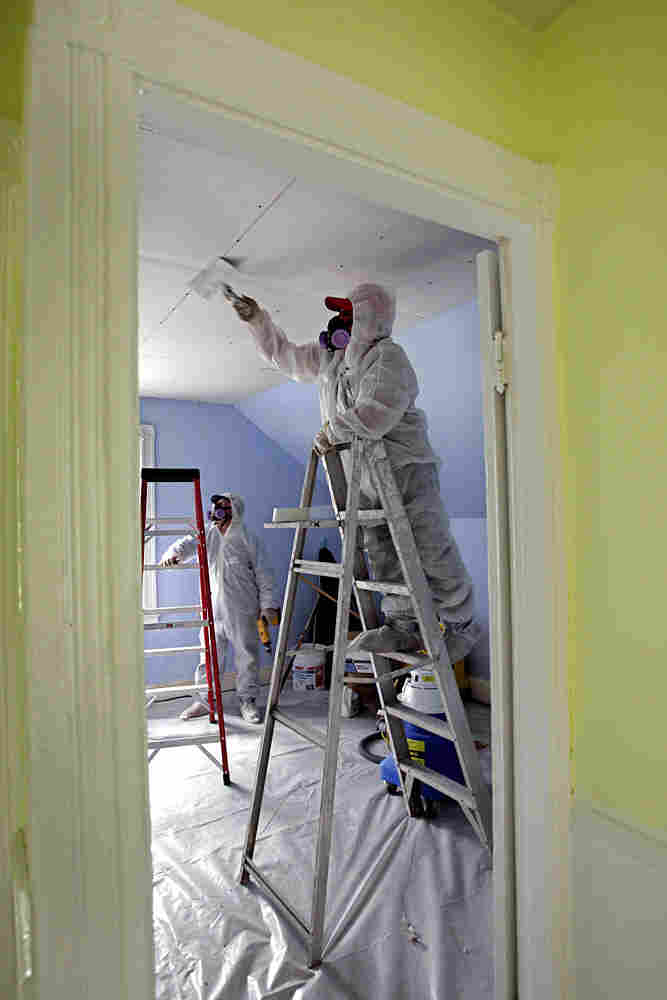Contractors clean up lead paint at a contaminated building in Providence, R.I.