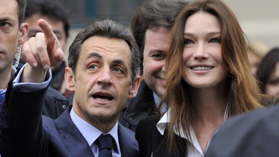 French President Nicolas Sarkozy and first lady Carla Bruni-Sarkozy leave a Paris polling station during the second round of the regional election on March 21, 2010. Unsubstantiated rumors of infidelity have plagued the couple, and now, some say the president has grown paranoid in his attempts to uncover the source of the rumors.