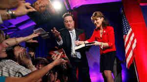 Sarah Palin signs autographs. Gerald Herbert/AP