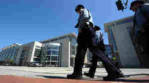 Policemen walk past the Washington Convention Center. Jewel Samad/AFP/Getty Images