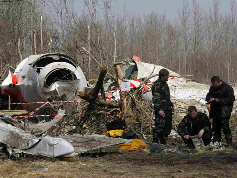 Russian investigators work near the wreckage. Mikhail Metzel/AP
