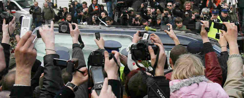 Mourners take photographs of President Lech Kaczynski's hearse. Katarzyna Mala/AP